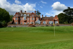 18th green view of Tyrrells Wood Golf Club House