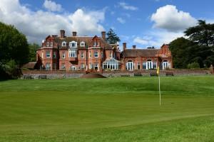 18th green view of Tyrrells Wood Golf Club House